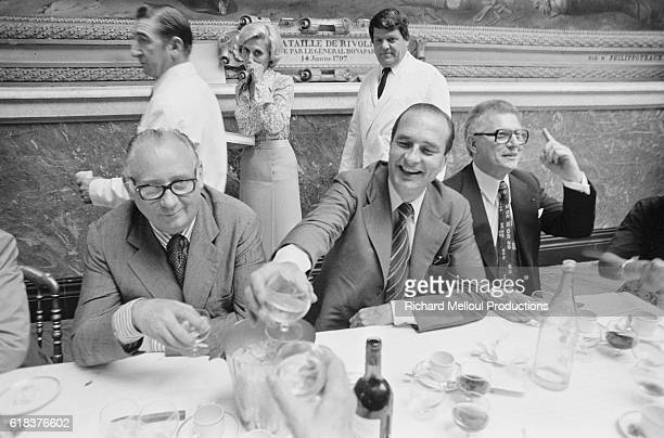 President of the political party Rassemblement pour la Republique Jacques Chirac and French Senator JeanPierre Fourcade laugh over drinks with other...