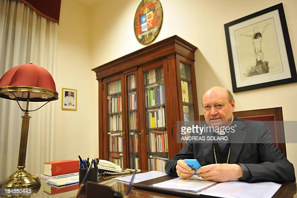 President of the Pontifical Council for Culture since 2007 Cardinal Gianfranco Ravasi poses with the mobile phone he uses for tweeting on December 2...