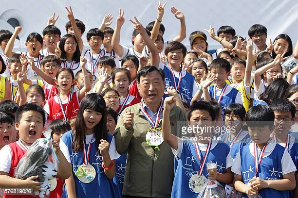 President of the PyeongChang Organizing Committee for the 2018 Olympic and Paralympic Winter Games Lee HeeBeom and students attend the press event to...