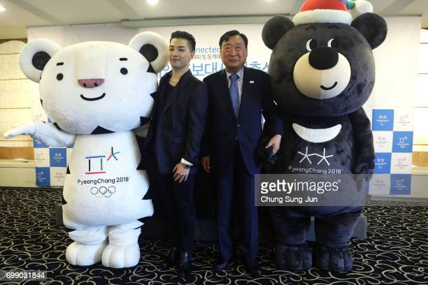 President of the PyeongChang Organizing Committee for the 2018 Olympic and Paralympic Winter Games , Lee Hee-Beom and singer and songwriter Taeyang...