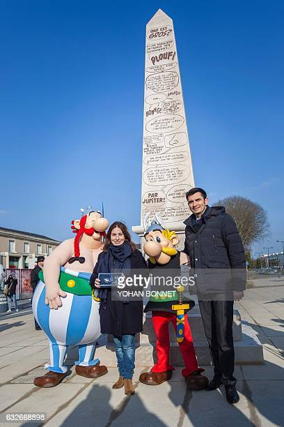 President of the Rene Goscinny Institute Anne Goscinny and Mayor of Angouleme Xavier Bonnefont pose with people dressed as comic characters Asterix...