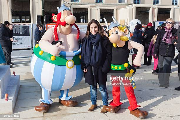 President of the Rene Goscinny Institute Anne Goscinny poses with people dressed as comic characters Asterix and Obelix during the unveiling of a...