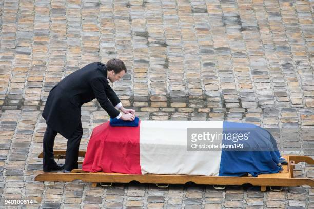 President of the Republic Emmanuel Macron attends a national tribute to Colonel Arnaud Beltrame at Hotel des Invalides on March 28 2018 in Paris...