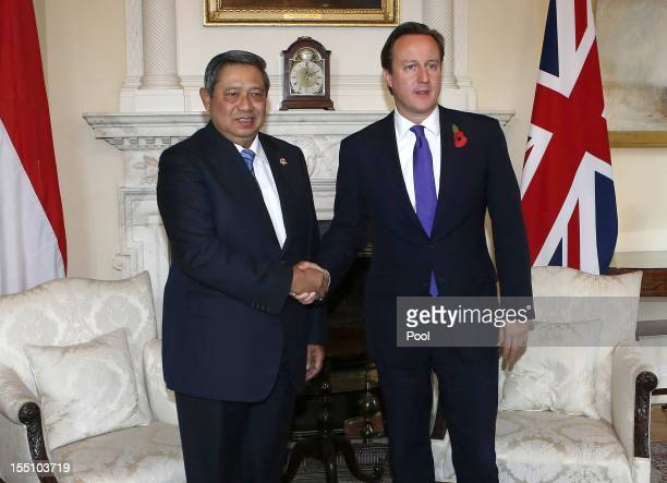 President of the Republic of Indonesia Susilo Bambang Yudhoyono shakes hands with British Prime Minister David Cameron during a meeting on the second...