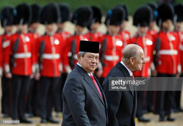 President of the Republic of Indonesia Susilo Bambang Yudhoyono walks with Prince Philip Duke of Edinburgh after reviewing the Guard of Honour during...