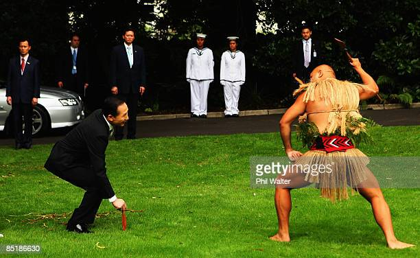 President of the Republic of Korea Lee Myungbak accepts the rautapu a symbolic offering of peace laid down by Marshall Cook during the Powhiri a...