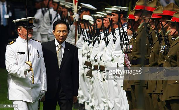 President of the Republic of Korea Lee Myungbak inspects a guard of honour after the Powhiri a Maori welcome ceremony held at Governement House on...