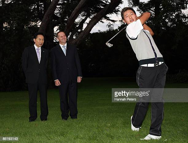 President of the Republic of Korea Lee Myungbak looks on with New Zealand Prime Minister John Key as Koreanborn New Zealand golfer Danny Lee...