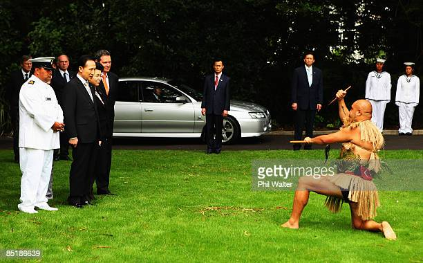 President of the Republic of Korea Lee Myungbak watches the rautapu a symbolic offering of peace laid down by Marshall Cook during the Powhiri a...