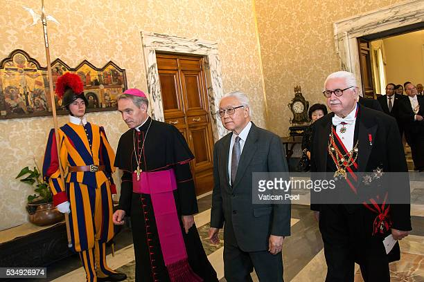 President of the Republic of Singapore Tony Tan Keng Yam, flanked by Prefect of the Pontifical House Georg Ganswein, arrives at the Apostolic Palace...