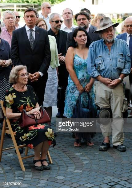 President of the Republic of Slovenia Borut Pahor German Artist Gunter Demnig and Auschwitz survivor Erika Furst attend the laying of a...