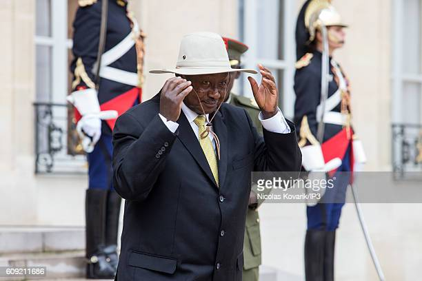 President of the Republic of Uganda Yoweri Kaguta Museveni goes out after a meeting with French President Francois Hollande at the Elysee Palace on...