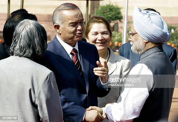 President of the Republic of Uzbekistan Islam A Karimov gestures while shaking hands with Indian Prime Minister Manmohan Singh as Indian President A...