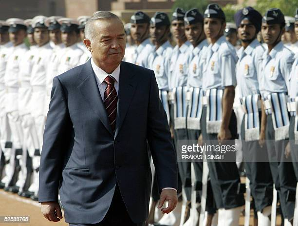 President of the Republic of Uzbekistan Islam A Karimov inspects a guard of honour of Indian troops during a ceremonial reception at The Presidential...