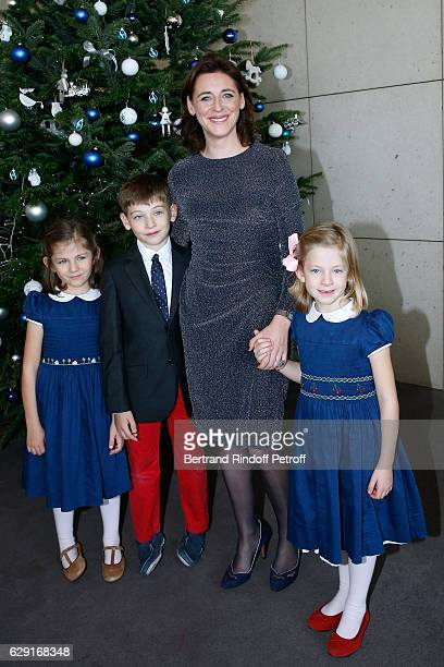 President of the 'Reve d'Enfants' Committee Valentine Denjoy with her son and her twins daughters attend the 'Reves d'Enfant' Charity Gala with the...