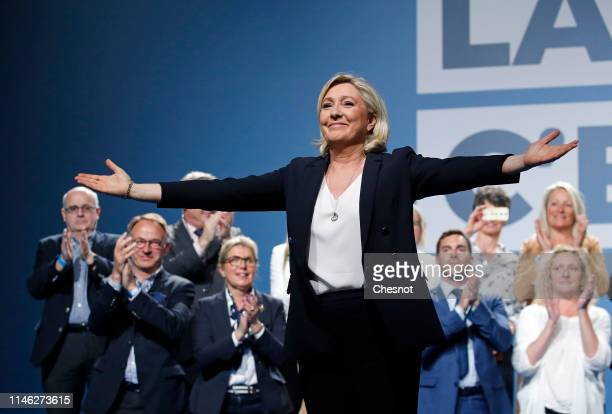 President of the rightwing populist National Rally party Marine Le Pen waves during a campaign meeting for upcoming European Elections' on May 01...