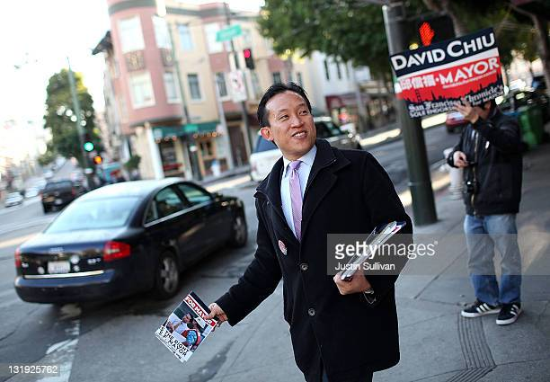 President of the San Francisco Board of Supervisors and mayoral candidate David Chiu looks on as he campaigns on a street corner in North Beach on...