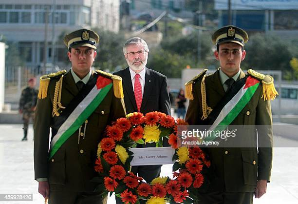 President of the Sinn Fein political party Gerry Adams stands in silence after places a wreath to Mausoleum of former Palestinian leader Yasser...