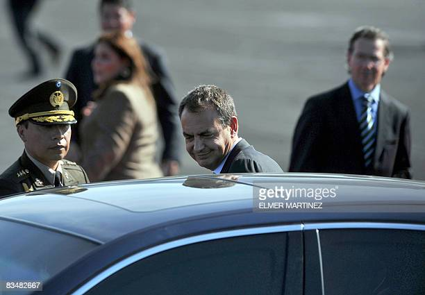 President of the Spanish Government Jose Luis Rodriguez Zapatero enters a car upon his arrival to El Salvador's airport in Comalapa some 45 kms south...