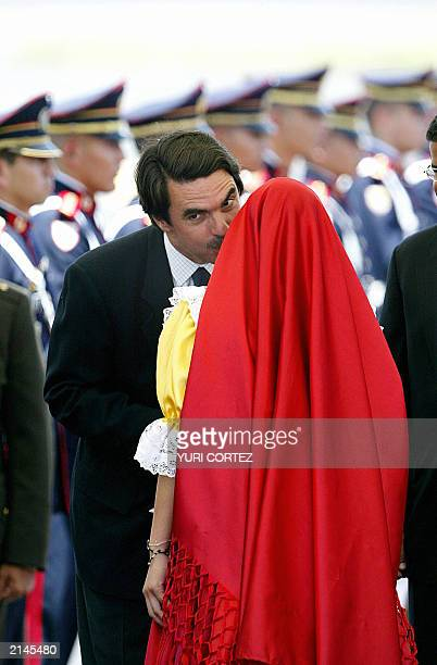President of the Spanish Government Jose Maria Aznar kisses a girl wearing a traditional Salvadorean attire during the welcoming ceremony upon his...