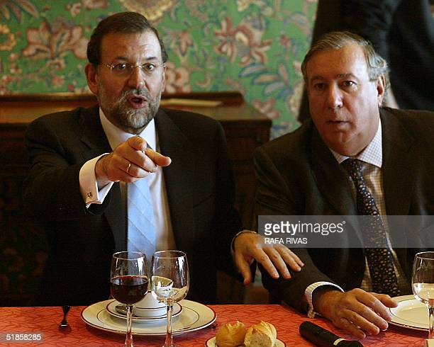 President of the Spanish Popular Party Mariano Rajoy talks to Alfonso Basagoiti IBV Corporation representative during a lunch with the Basque...