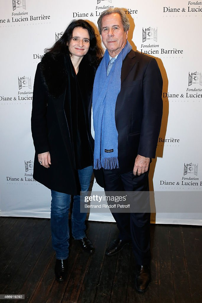 President of the State Council Jean-Louis Debre (R) and Valerie Bochenek attend movie 'Les Chateaux de Sable' receives Cinema Award 2015 of Foundation Diane & Lucien Barriere during the premiere of the movie at Publicis Champs Elysees on March 19, 2015 in Paris, France.