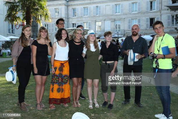 President of the Student Jury Claire Borotra poses with the Student Jury during the 12th Angouleme FrenchSpeaking Film Festival Day Five on August 24...