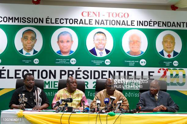 President of the Togolese Independent National Electoral Commission Tchambakou Ayassor flanked by other members of the commission announces the...