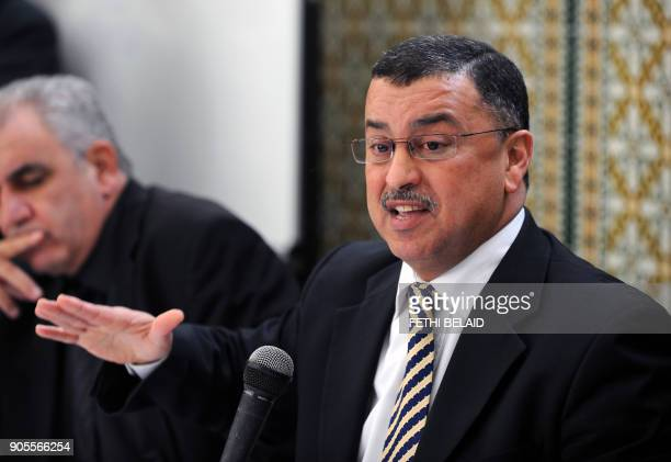 President of the Tunis section of the Tunisian Bar Association Abderrazak Kilani gives a speech during a meeting with Tunisian lawyers as they show...