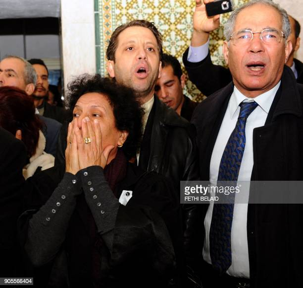 President of the Tunisian Human Rights League lawyer Mokhtar Trifi flanked by Tunisian lawyer and human rights activist Radhia Nasraoui along with...
