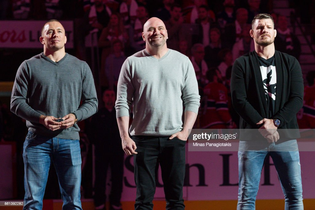President of the UFC Dana White stands in-between Georges St-Pierre (L) and defending middleweight UFC champion Michael Bisping during the NHL game between the Montreal Canadiens and the Toronto Maple Leafs at the Bell Centre on October 14, 2017 in Montreal, Quebec, Canada.