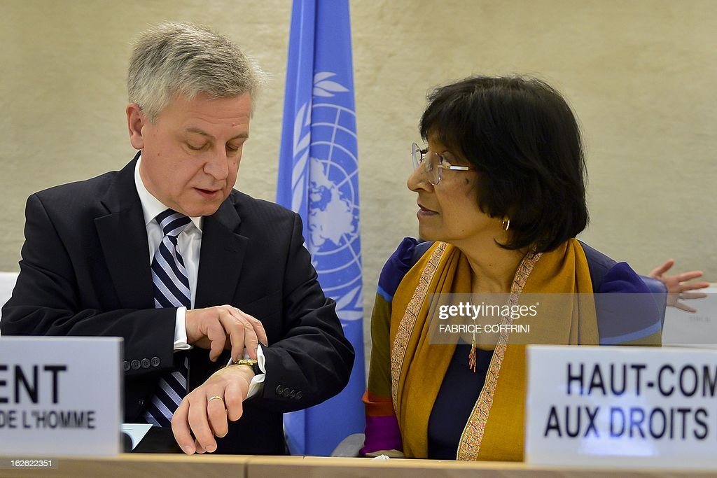 President of the United Nations Human Rights Council, Poland's Remigiusz Achilles Henczel (L) gestures next to High Commissioner for Human Rights Navi Pillay at the opening of the 22nd session of the UN Human Rights Council on February 25, 2013 in Geneva. The Council kicks off with widespread abuses in North Korea and Mali the top items on the agenda, along with the crisis in Syria.