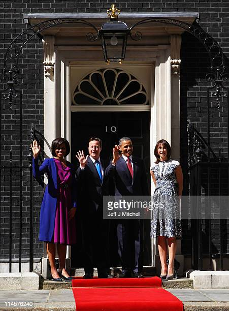 President of the United States Barack Obama and his wife Michelle are greeted by British Prime Minister David Cameron and wife Samantha outside...