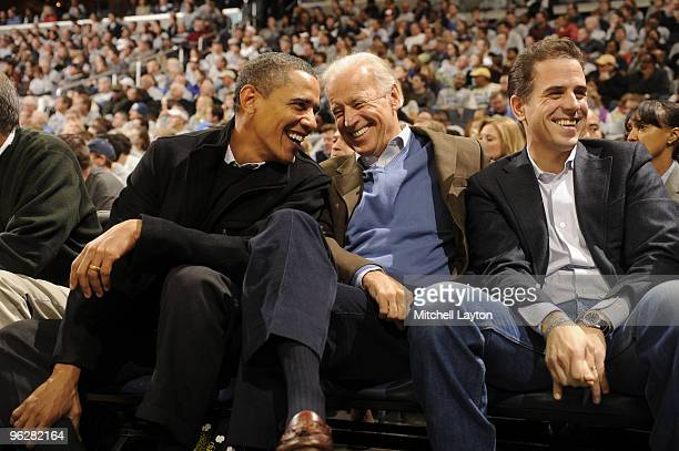 President of the United States Barack Obama and Vice President Joe Biden and Hunter Biden talk during a college basketball game between Georgetown...
