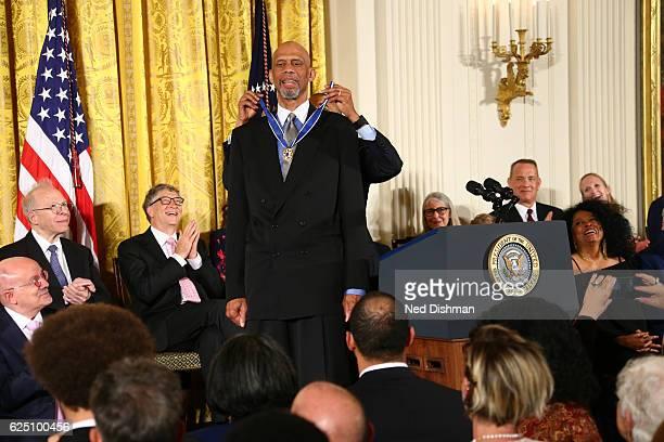 WASHINGTON DC NOVEMBER 22 President of the United States Barack Obama presents NBA Hall of Famer Kareem AbdulJabbar during a ceremony with the...