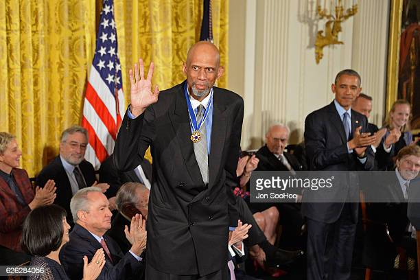 President of the United States Barack Obama presents NBA Hall of Famer Kareem AbdulJabbar with a medal during a ceremony for the Presidential Medal...
