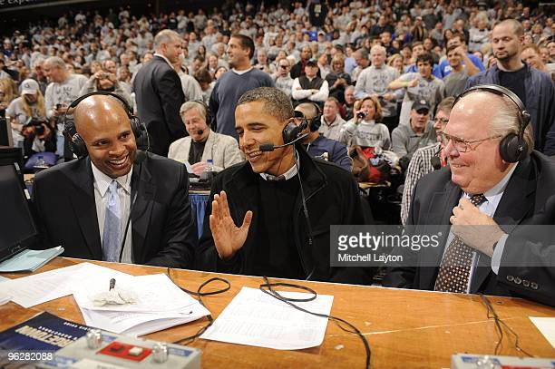 President of the United States Barack Obama talks to CBS annoucers Clark Kellogg and Verne Lundquist during a college basketball game between...