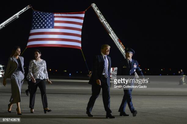 President of the United States Donald J Trump and First Lady Melania Trump walking with Col Casey D Eaton 89th Airlift Wing commander and his wife...