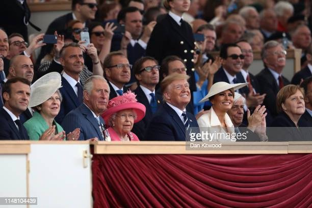 President of the United States Donald Trump and First Lady of the United States Melania Trump watch the flypast next to President of the France...