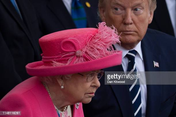 President of the United States Donald Trump and Queen Elizabeth II sit together during the DDay Commemorations on June 5 2019 in Portsmouth England...