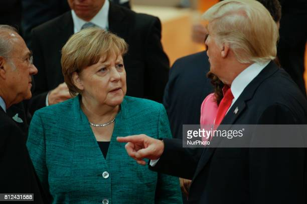 President of the United States Donald Trump is seen speaking with German chancellor Angela Merkel ahead of the thrid plenary session of the G20...