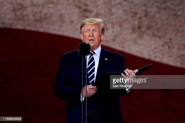 President of the United States Donald Trump reads from the 32nd US President President Franklin D Roosevelt's prayer to the US on stage during the...