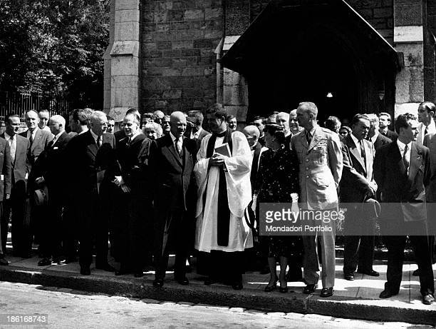 President of the United States Dwight David Eisenhower, leaving a church, talking with a priest. Beside them, American politician John Foster Dulles,...