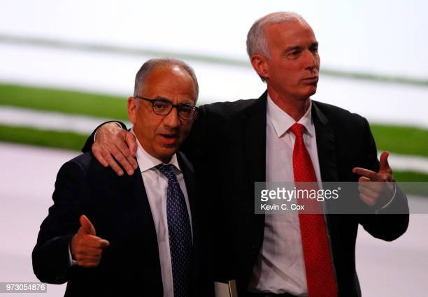 President of the United States Football Association Carlos Cordeiro and Steve Reed president of the Canadian Soccer Association celebrate after the...