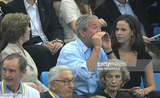 President of the United States George W Bush and daughter Barbara Bush and father George H W Bush attend the swimming finals at the National Aquatics...