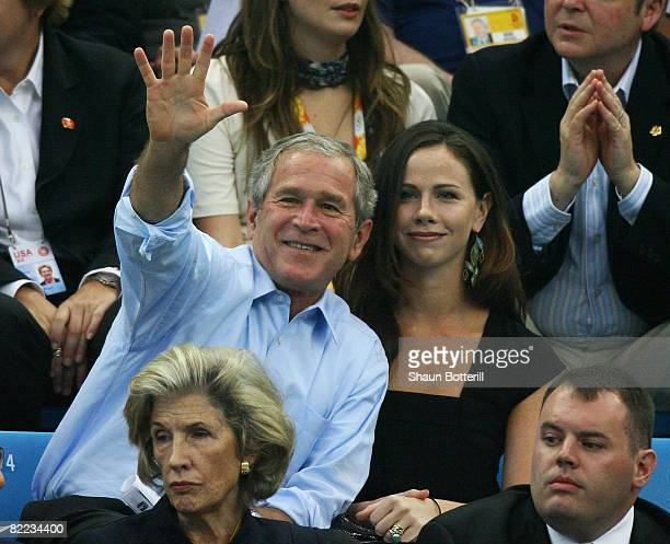 President of the United States George W Bush and daughter Barbara Bush sit in the swimming arena at the National Aquatics Center during day 2 of the...