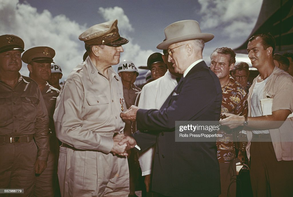 President of the United States, Harry S. Truman (1884-1972) awards the Distinguished Service Medal to General Douglas MacArthur (1880-1964) during the Wake Island Conference to discuss strategy during the Korean War conflict, on Wake Island in the Pacific Ocean on 15th October 1950.