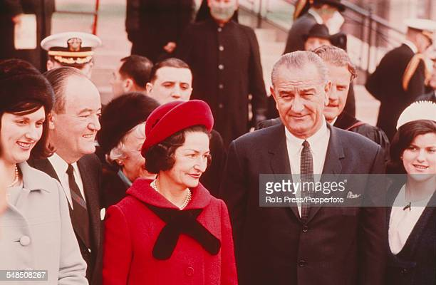 President of the United States Lyndon B Johnson arrives with his wife Lady Bird Johnson and Vice President Hubert Humphrey at the National City...