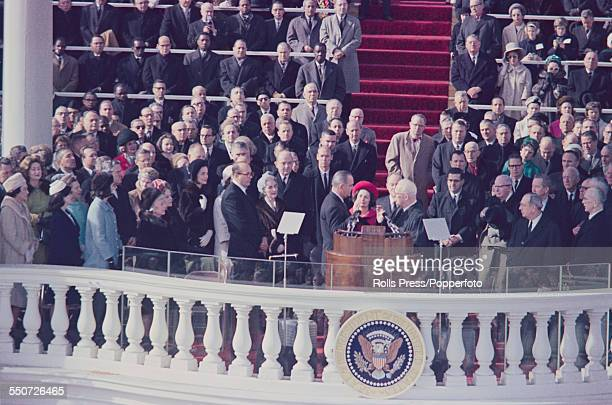 President of the United States Lyndon B Johnson being administered the oath of office by Chief Justice Earl Warren during the inauguration ceremony...