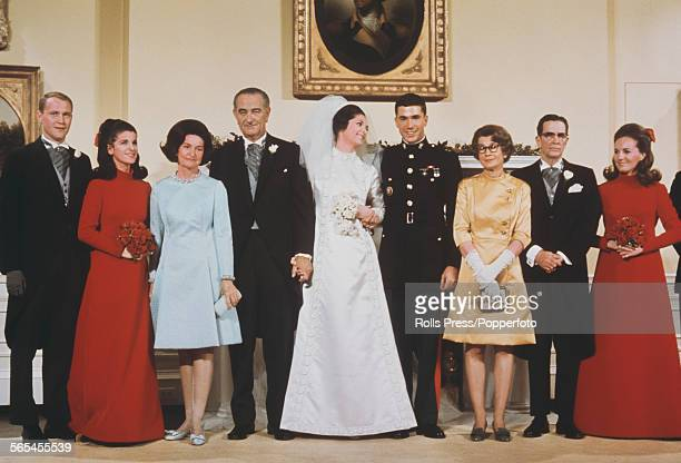 President of the United States Lyndon B Johnson pictured with family members at the wedding of his daughter Lynda Bird Johnson in Washington in...